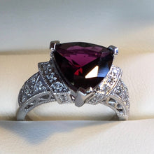 Plum colored garnet ring.