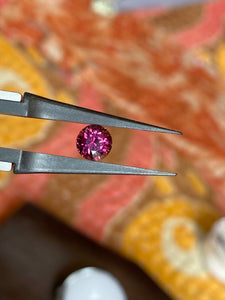 Malaya Garnet, 1.03 ct. Round Brilliant Cut to Diamond Standards,