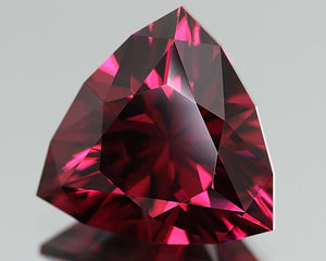 6.1 carat Malaya Pyralspite Color-Shift Garnet Trillion VVS