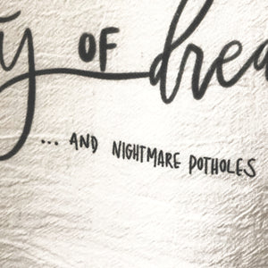 Flour Sack Tea Towel: City of Dreams... And Nightmare Potholes - SB Shop