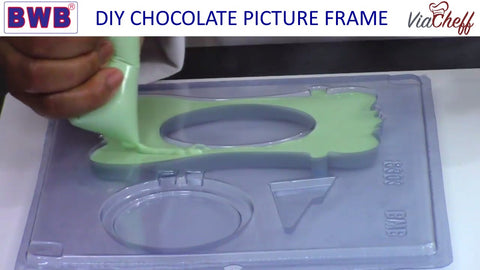 Filling the picture frame chocolate mold