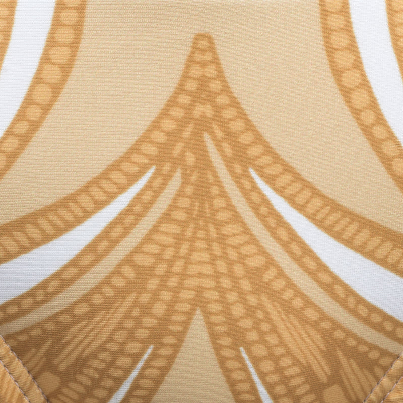 swimsuit fabric close up in a yellow paisley print