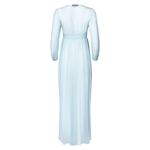 back of a silk chiffon maxi dress knotted at the waist in pastel blue