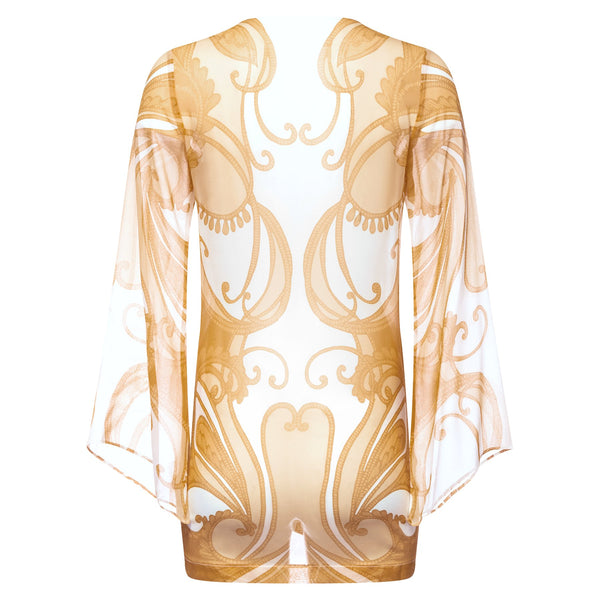 back of a mini silk kaftan with a deep v neckline in a yellow paisley print