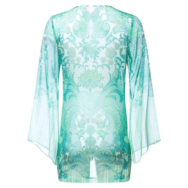 back of a mini silk kaftan with a deep v neckline in an emerald print