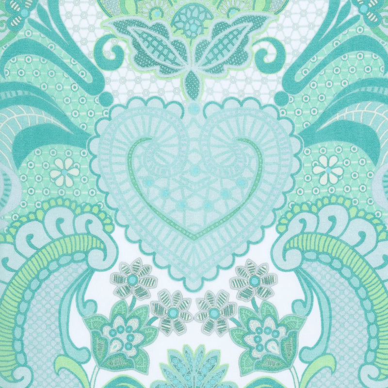 close up of a silk georgette fabric in an emerald print