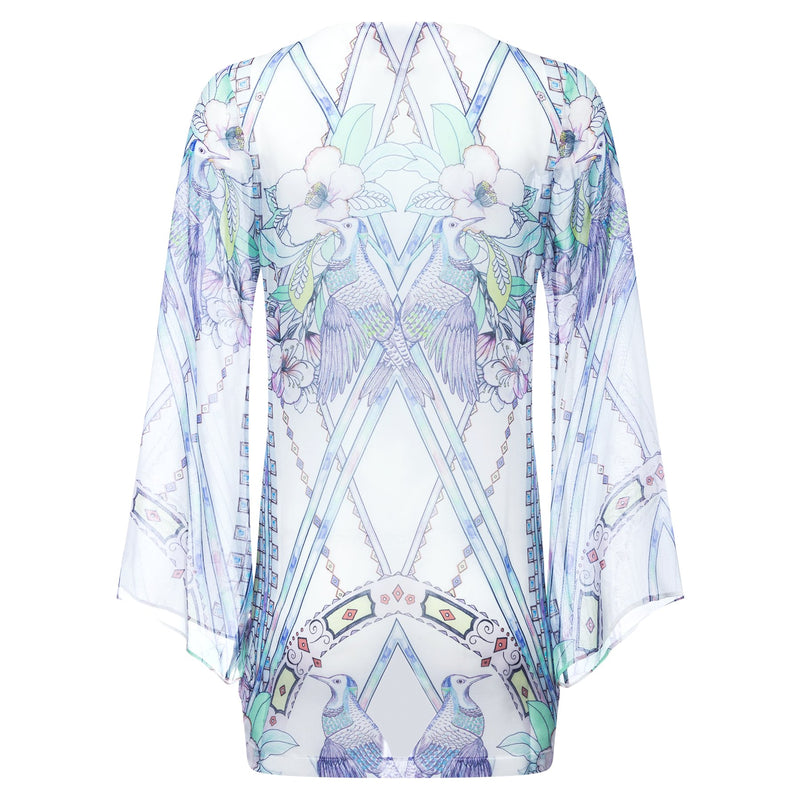 back of a mini silk kaftan with a deep v neckline in a multicolor pastel print