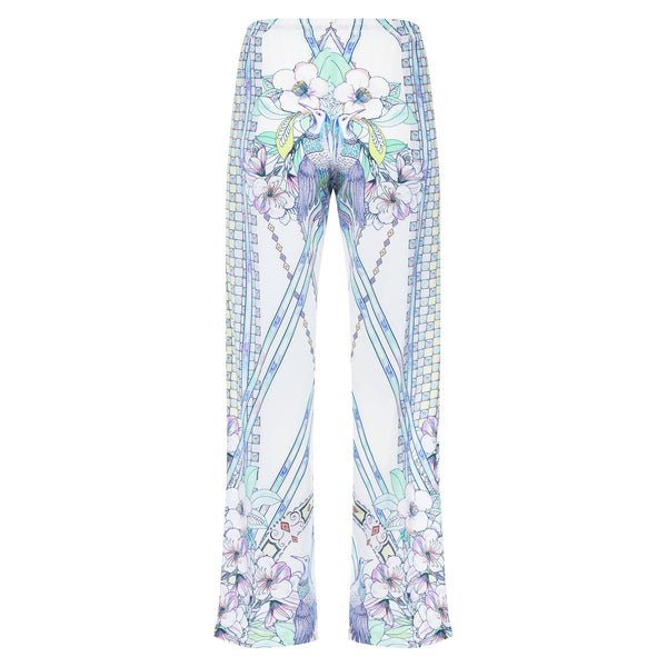 back of a women wide leg silk palazzo pants in a multicolor pastel print