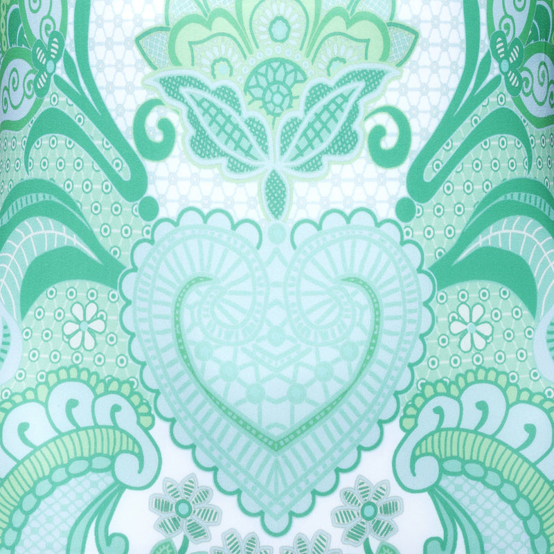 swimsuit fabric close up in an emerald print