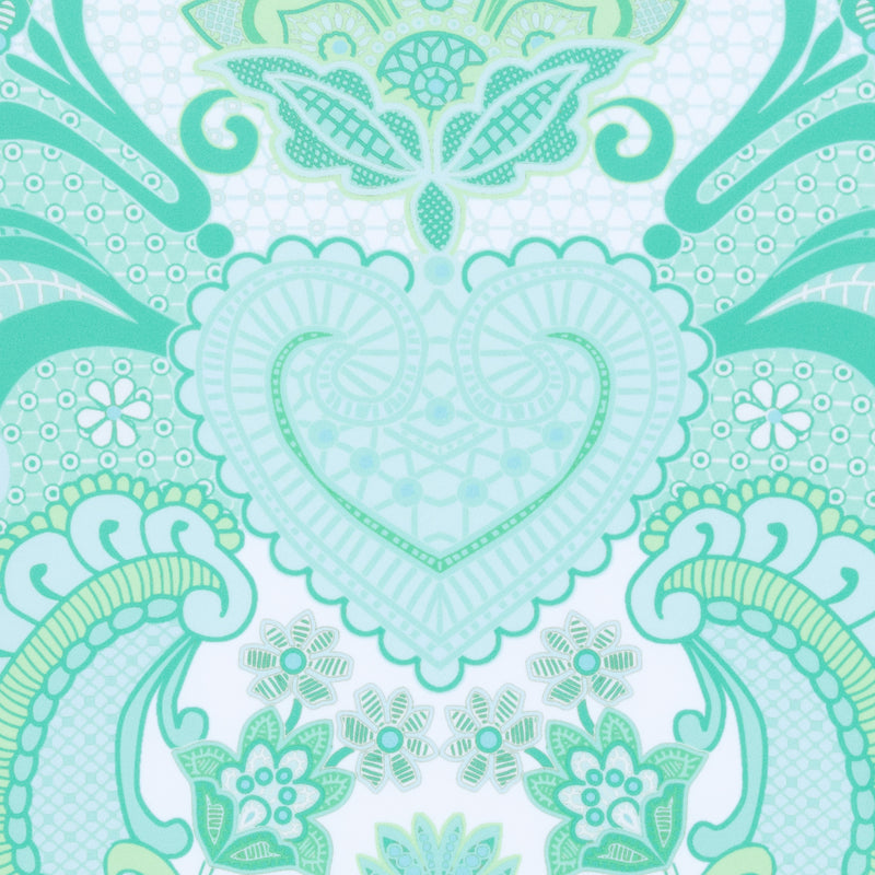 close up of a swimsuit fabric in an emerald print