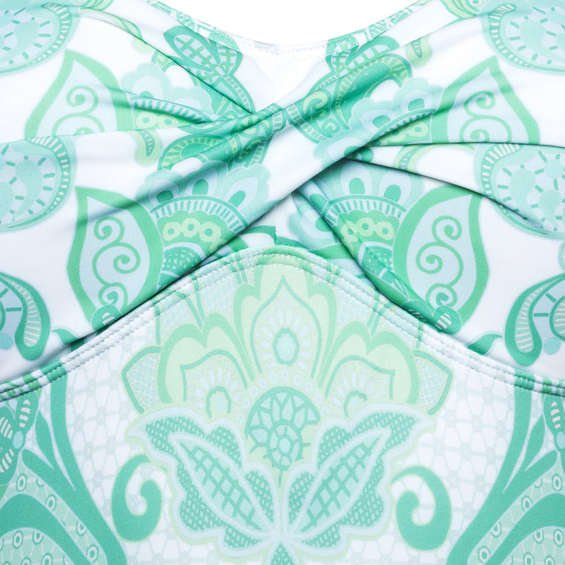detail of a one-piece strapless swimsuit in emerald print