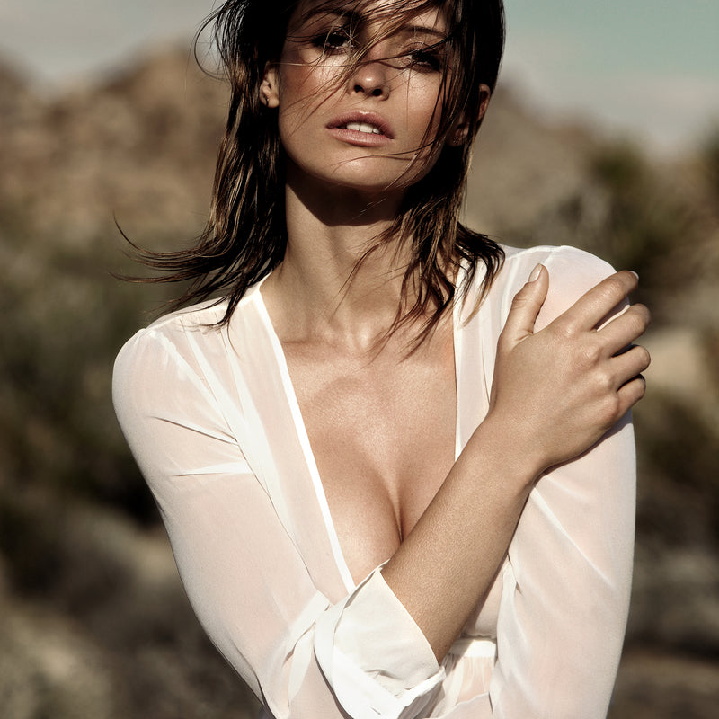 close up of a woman in a white silk chiffon dress in the desert of palm springs