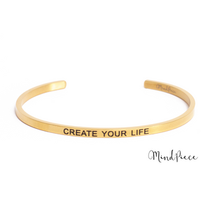 Gouden bangle quote armband met de tekst Create your life
