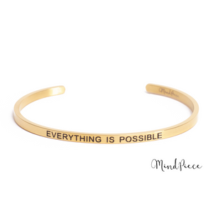 Gouden bangle quote armband met de tekst Everything is Possible