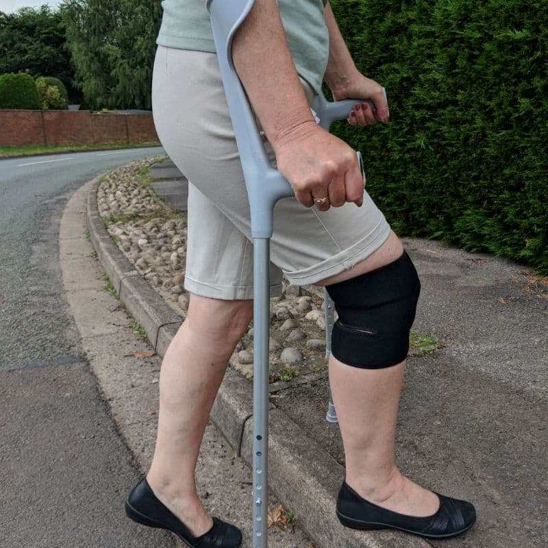 Essential Wellness Knee Support with crutches