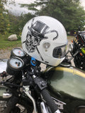 helmet with skull on motorcycle