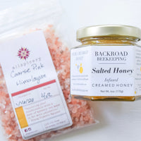 Pink himalayan salt in a bag beside a jar of salted honey