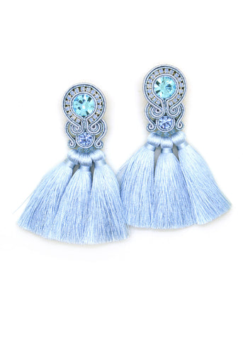 Earrings with tassels in light blue color