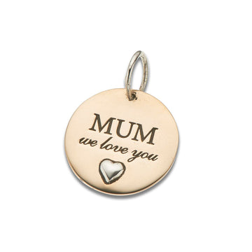 Round gold charm with silver bail, silver heart and text