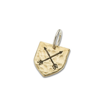 Shield shaped brass charm with crossed arrows