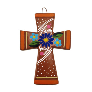 Terracotta coloured ceramic cross with painted flowers and orange edging