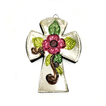 Dark wooden curved edge cross with tin front and embossed and painted flower design