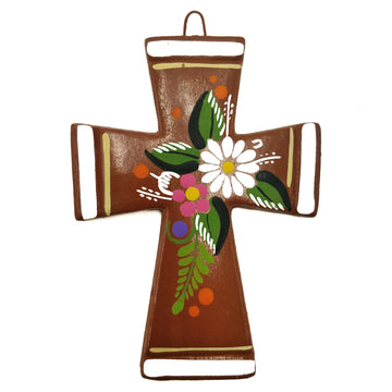 Terracotta coloured ceramic cross with painted flowers and white edging