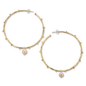 Brass hoop earrings with silver dots around the edge, silver posts and hanging pearl at the bottom