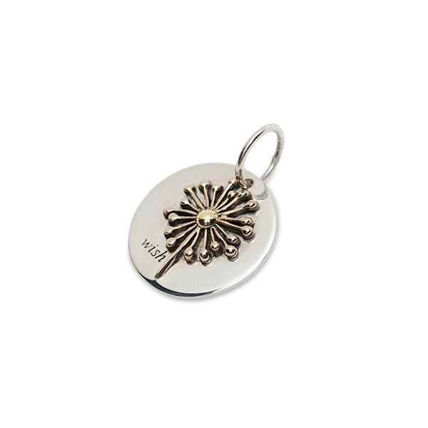 Round silver charm engraved 'wish' with raised brass and bronze dandelion