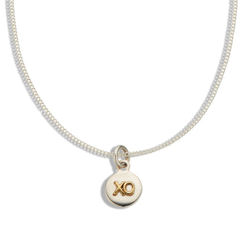 Fine silver chain and silver disk with raised brass 'XO'