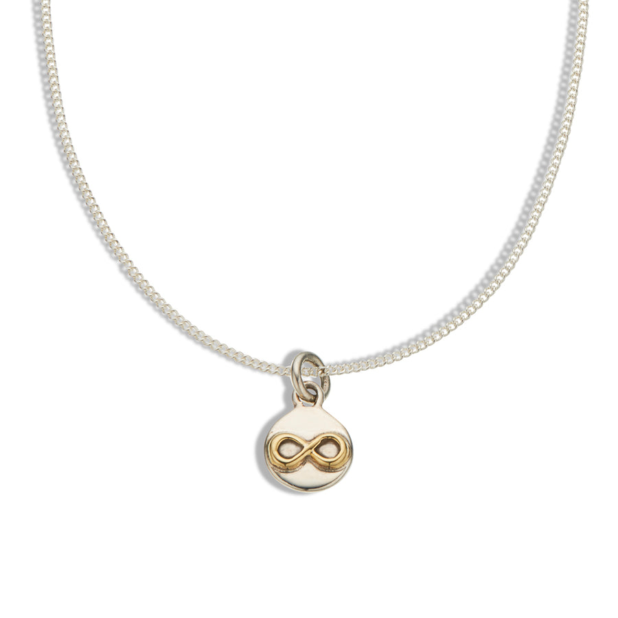 Fine silver chain and silver disk with raised brass infinity symbol