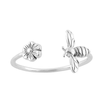Silver open ring with a flower on one end and a bee on the other