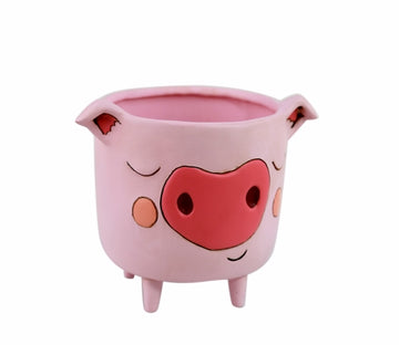 Pink planter with four legs and pig face and ears