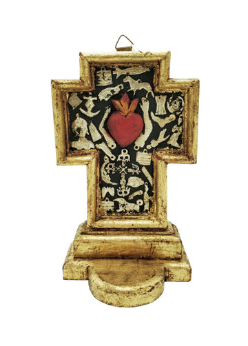 Black wooden cross with gold edging, red heart and silver milagros