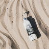The Travel Bottle Egypt Flat Lay On Sand Product Photo 1024x1024