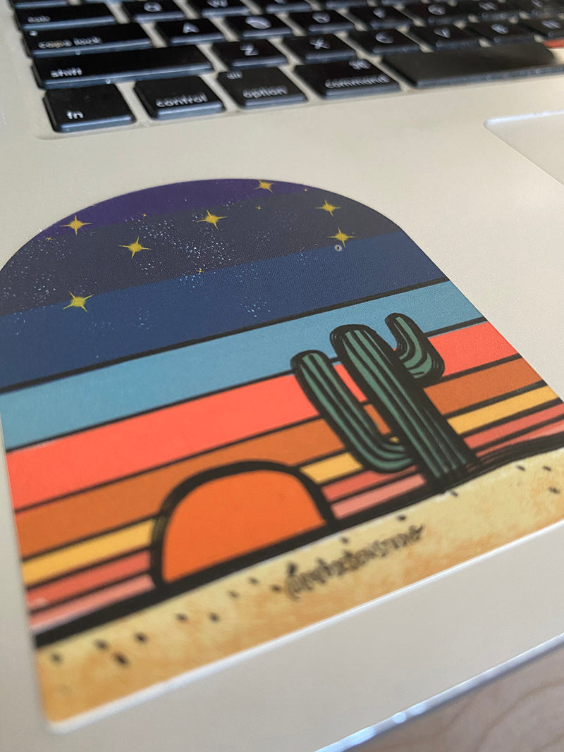 bobo design studio sticker of cactus at sunset titled Desert Globe on a laptop