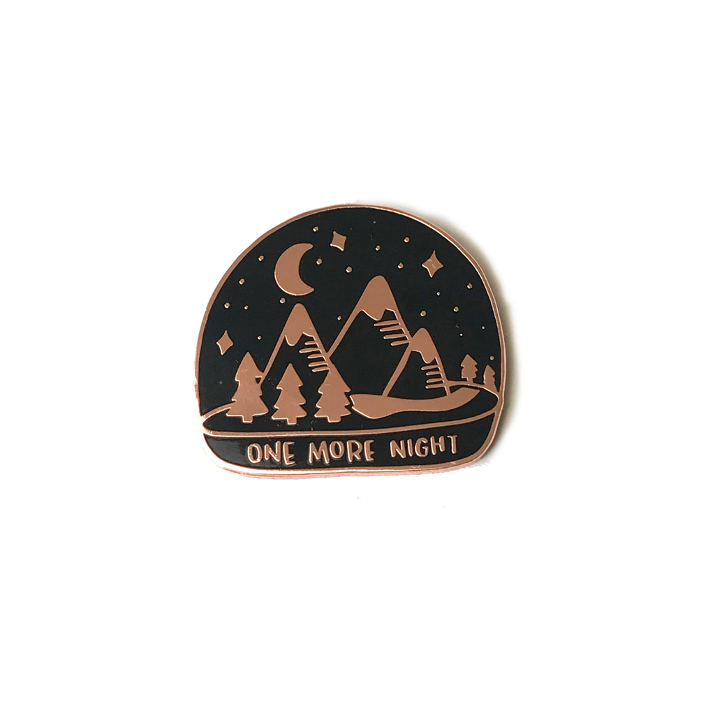 one more night enamel pin photographed on white background. Wholesale line sheet item