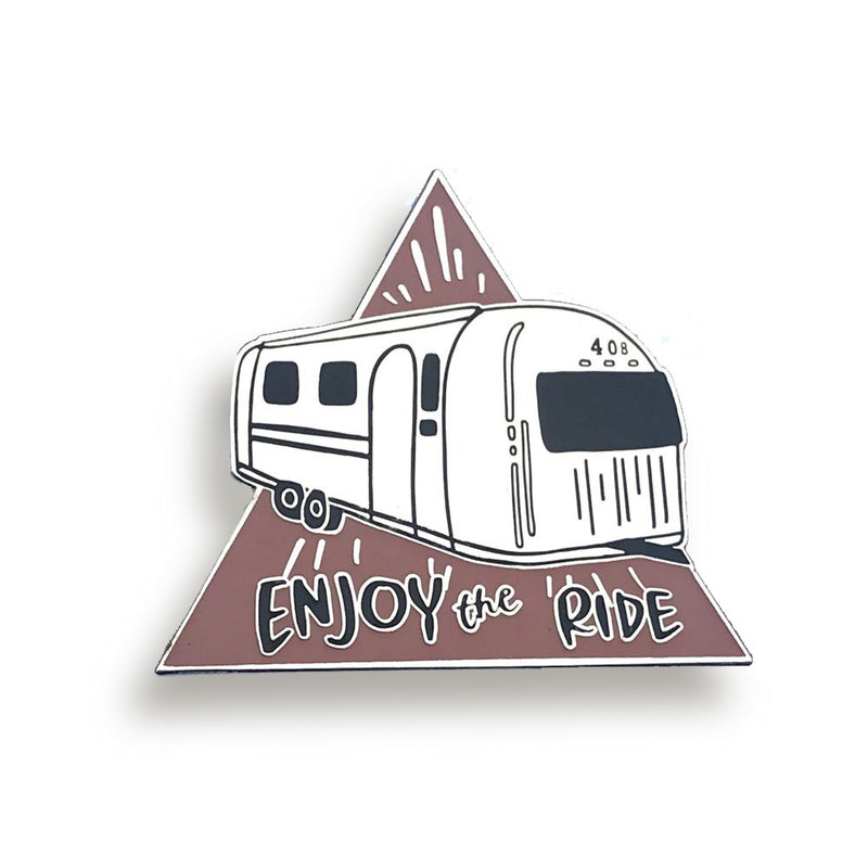 bobo design studio enjoy the ride airstream enamel pin on white background