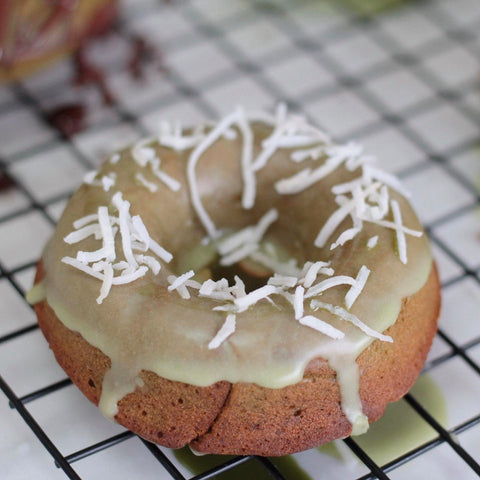 Photo of matcha cake donut with coconut on top