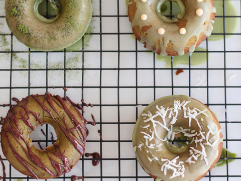 Photo of matcha green tea cake donuts with various toppings