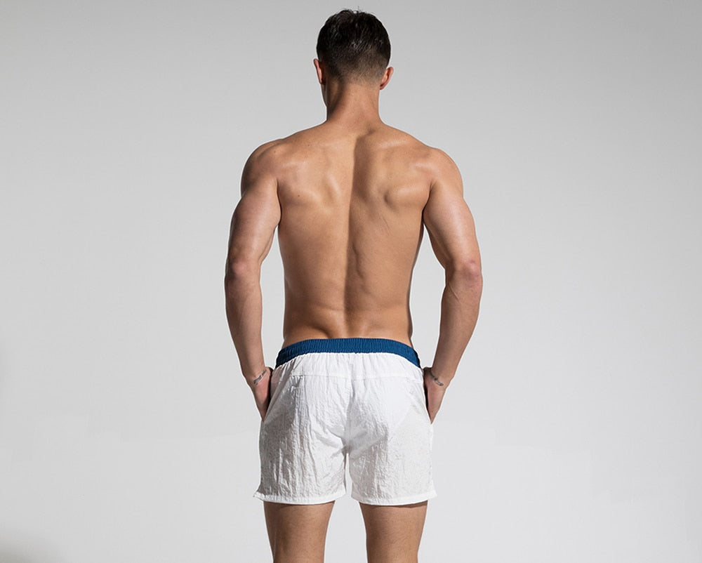 Sexy Fast Dry Mens White Board Shorts Summer Beach Surfing Man Swimming Shorts Athletic Sport Running Hybrid Man Shorts