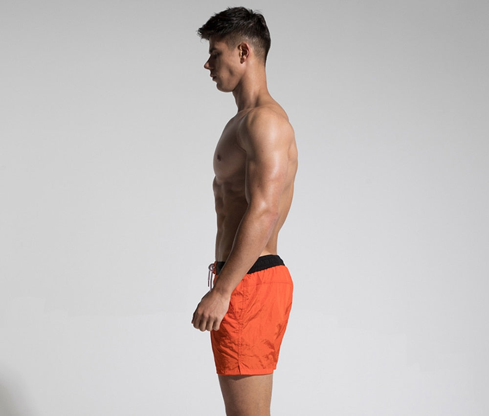 Trending Fast Dry Mens Orange Board Shorts Summer Beach Surfing Man Swimming Shorts Athletic Sport Running Hybrid Man Shorts