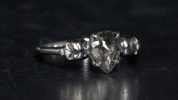 Salt and pepper diamond alternative engagement ring in silver with silver skulls