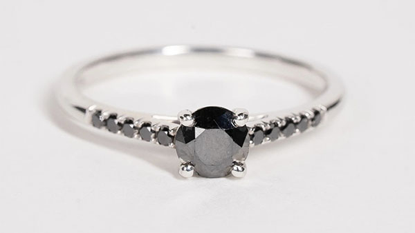 Round salt and pepper diamond engagement ring with fine white gold band