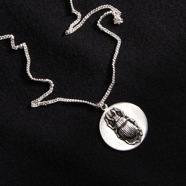 Beetle disc necklace by bonearrow  jewellery