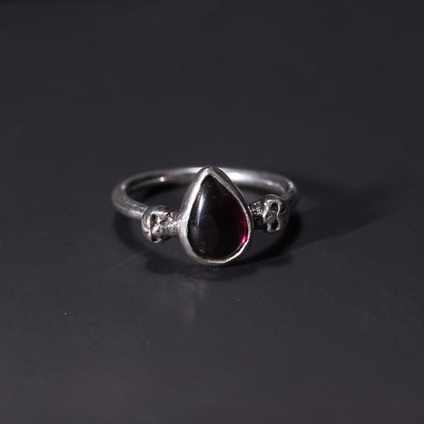 Garnet and sterling silver skulls gothic ring handmade in the UK