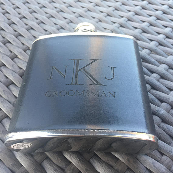 Flask - This black leather wrapped flask is everything a guy could ask for.