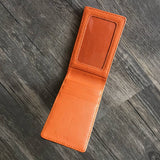 Inside of the black leather wallet. Orange leather