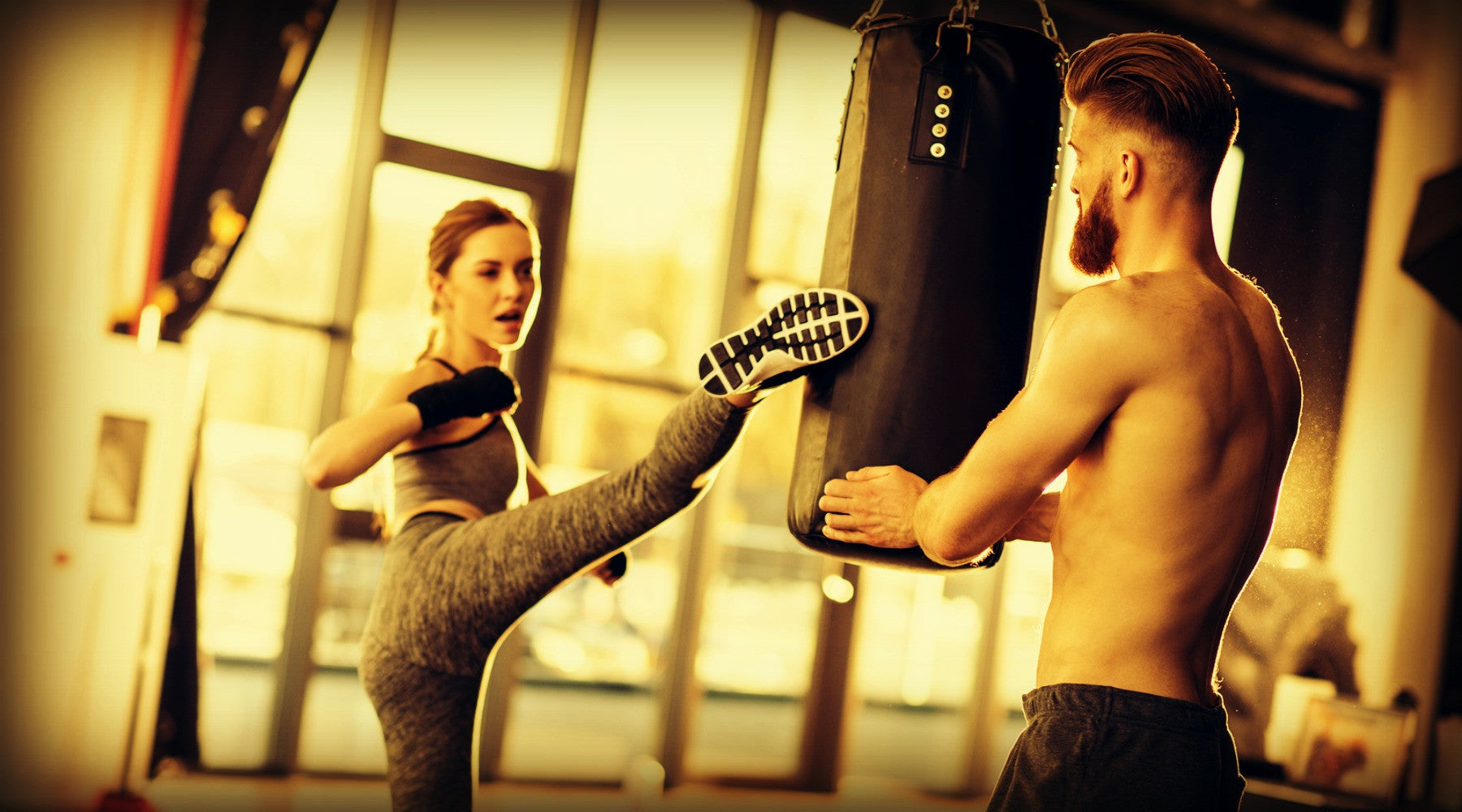 Woman kickboxing with instructor