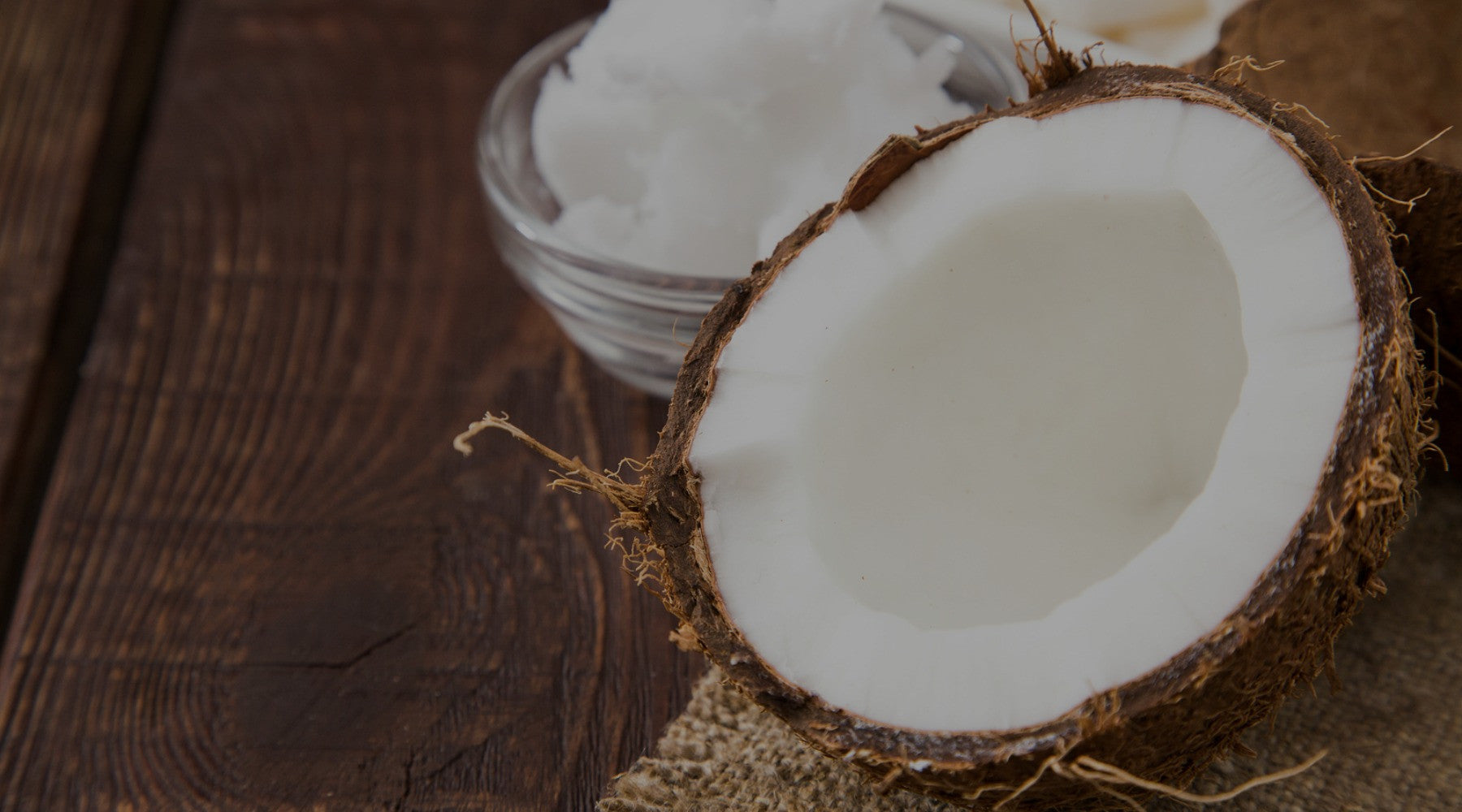 Coconut and coconut oil on a table